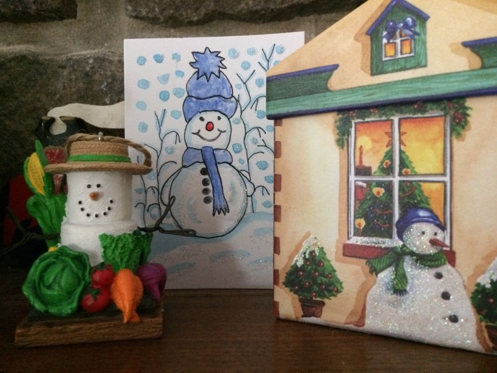 Doesn't the card snowman look happy to be hanging out with other snowmen on my mantle?