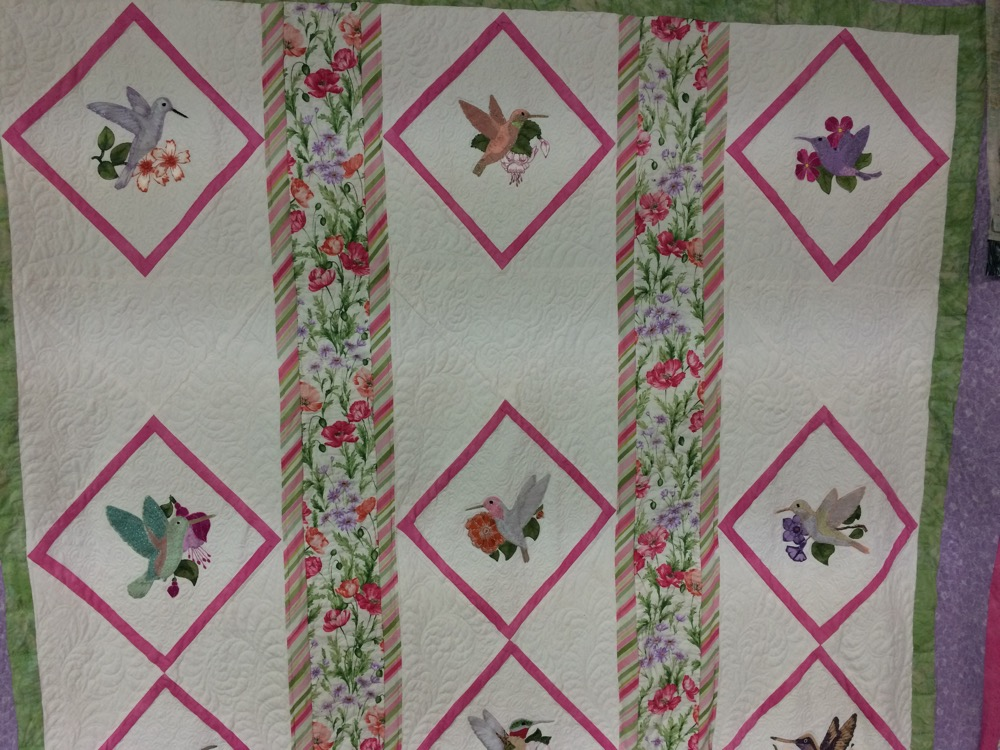Some of the hummingbird panels together with a strip of floral fabrics in between.