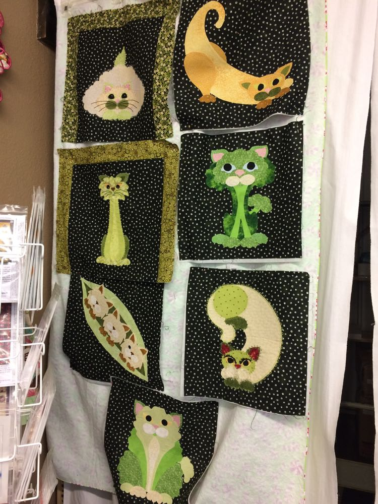 Charming applique cats quilt blocks with a definite St. Patrick's Day green theme.