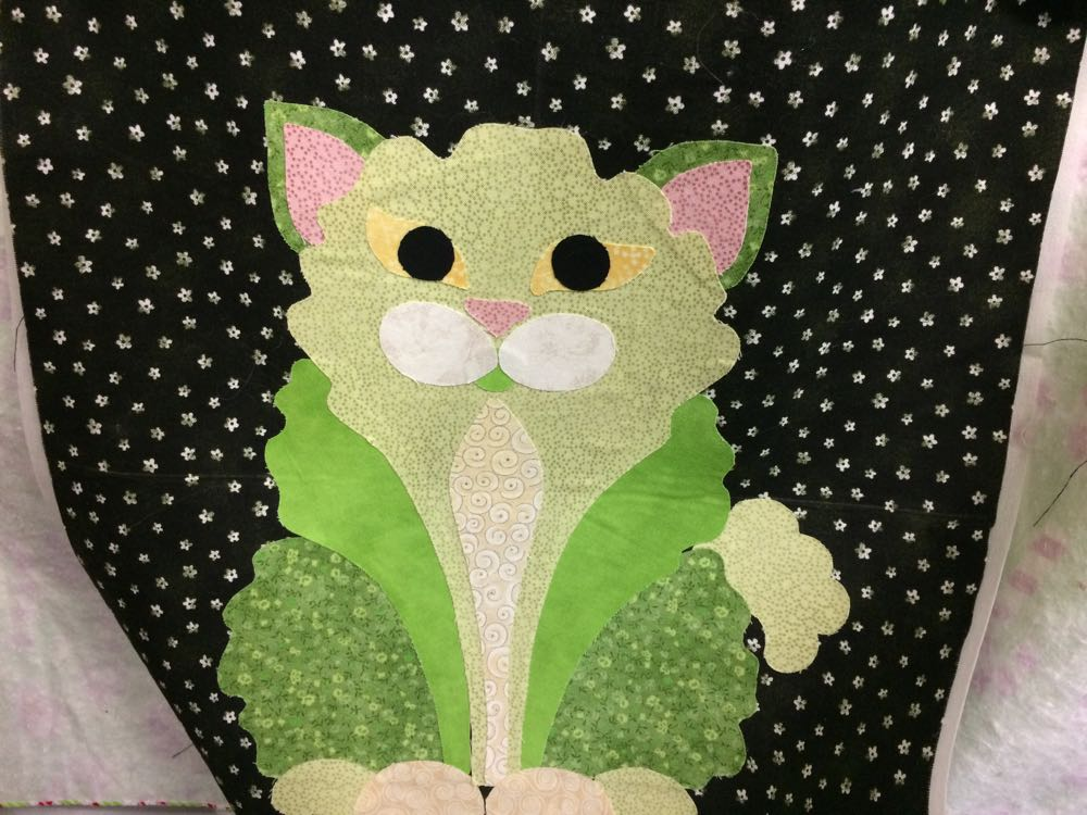 This little green cat makes me smile, wearing a little green tux so happy and welcoming.