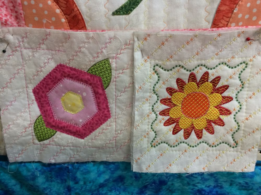 Two more floral quilt blocks add bright colors to the possible quilt design.