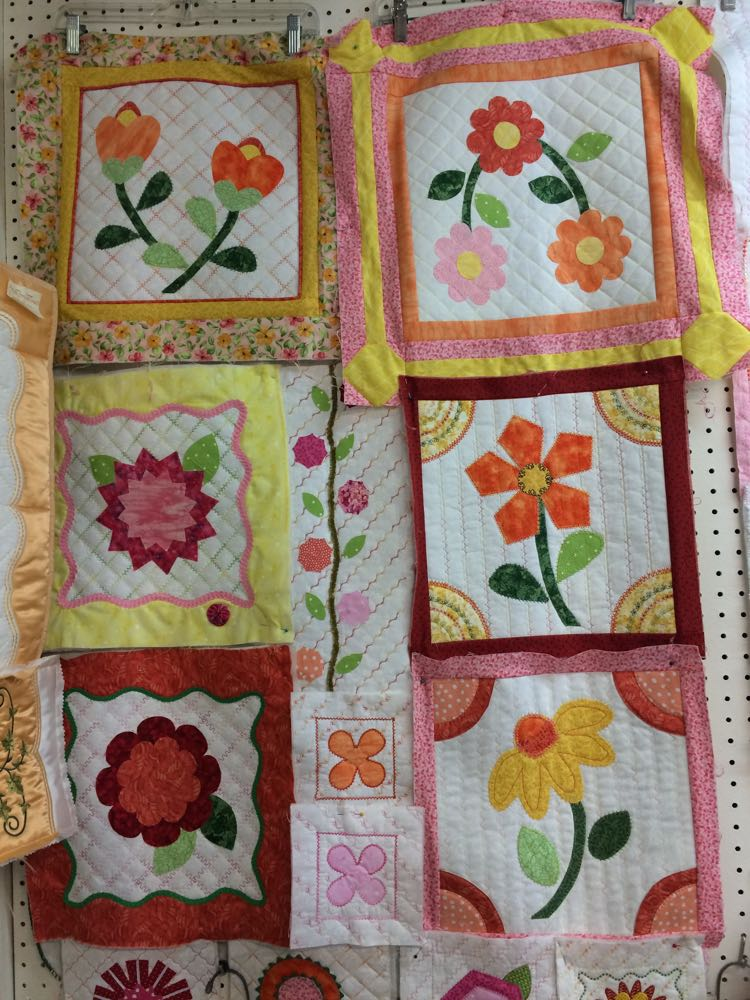 Flower quilt blocks now pulled together almost as a quilt. Almost, but not quite!