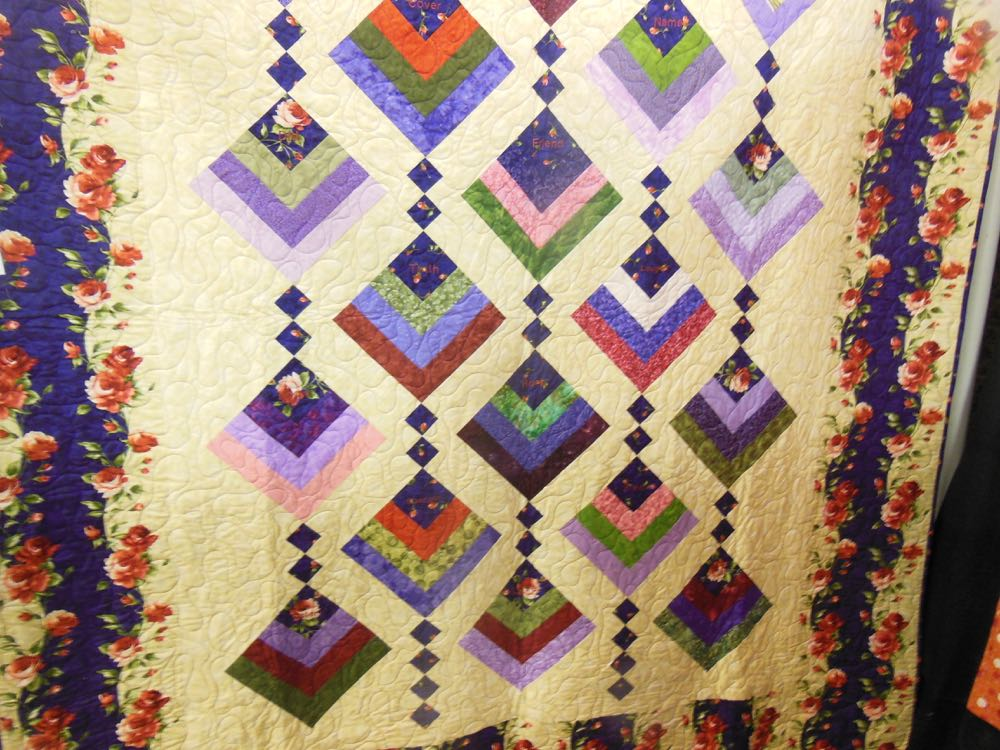 This custom handmade quilt combined floral prints with patchwork blocks and special words.