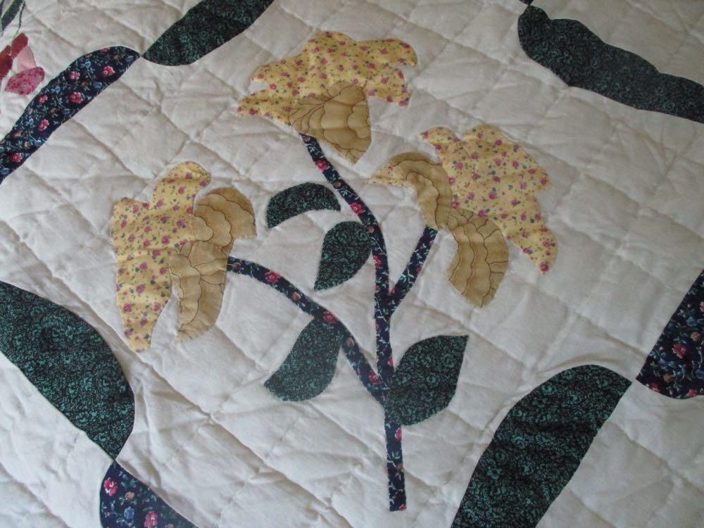 A pop of yellow brightens Birds in Flowers Handmade Quilt in between blocks with birds.