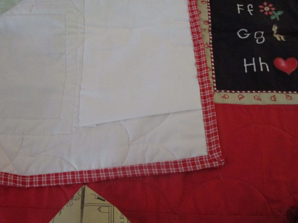 A sleeve on the back easily turns this charming baby crib quilt into a quilted wall hanging.