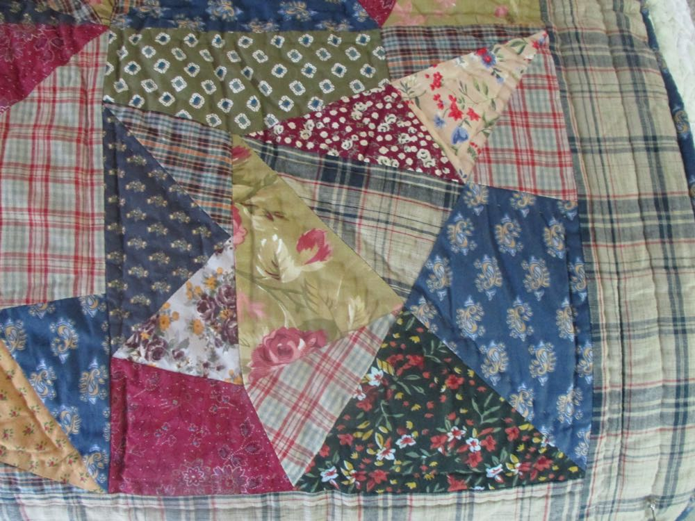 Crazy quilts weave all sorts of mixed fabric pieces and designs to make the overall design.