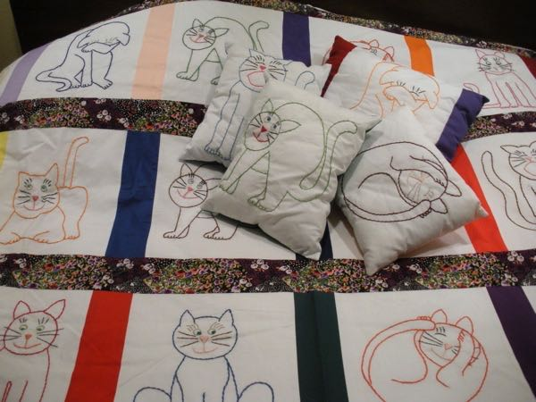 See how the pillows look against the quilt blocks?