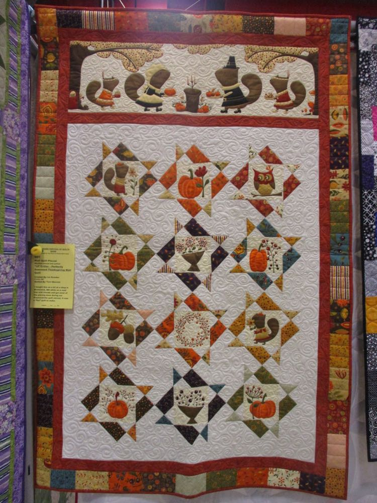 From a distance, the overall quilting in the white space adds a nice dimension to the quilt.
