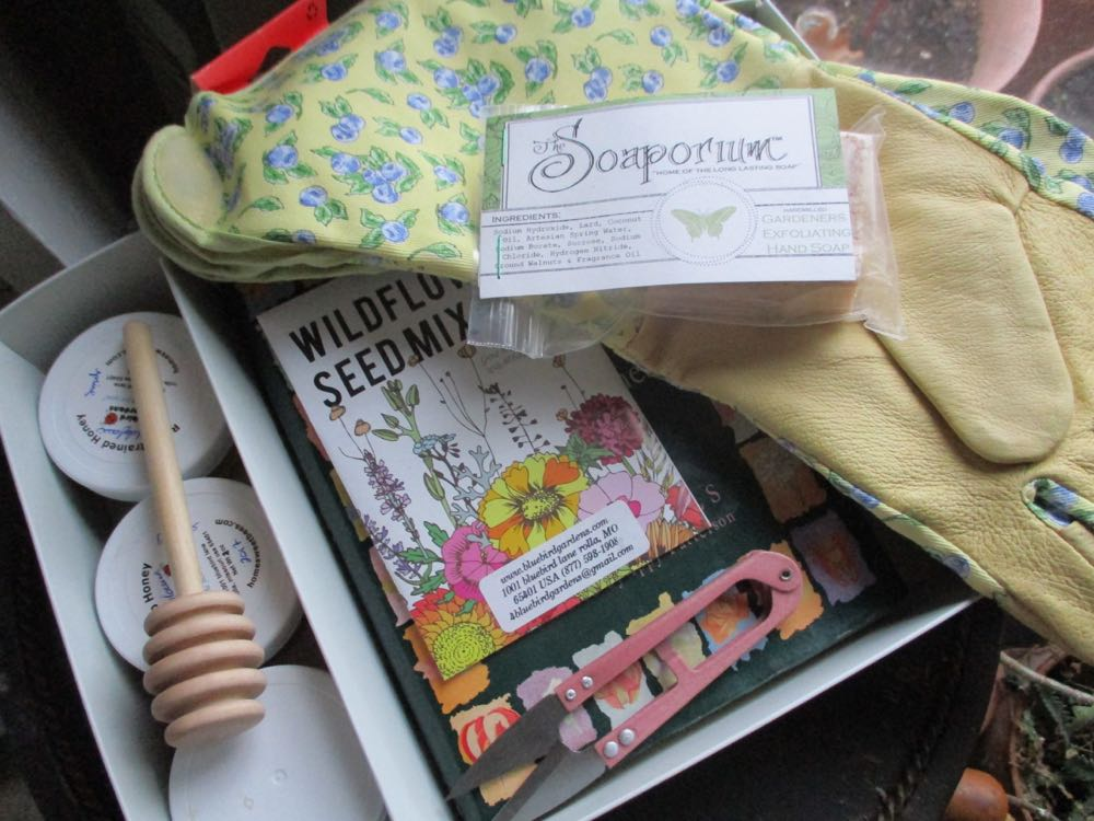 Wildflower seeds, plant snips, leather gardening gloves, gardener soap and a honey dipper.