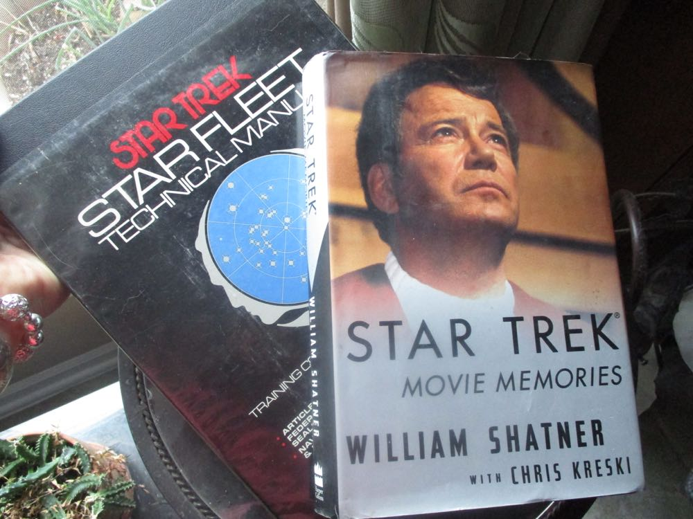 Two autographed Star Trek books are currently up for auction on Ebay.