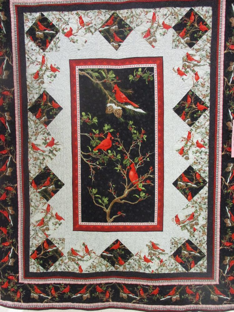 Winter Reds Handmade Quilt was shared at the fall Piece and Plenty Quilt Guild show in Rolla.