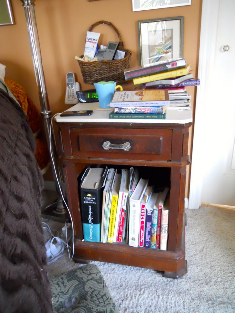 BEFORE: One of my most-used reading nooks is beside my bed and a bit of a mess!