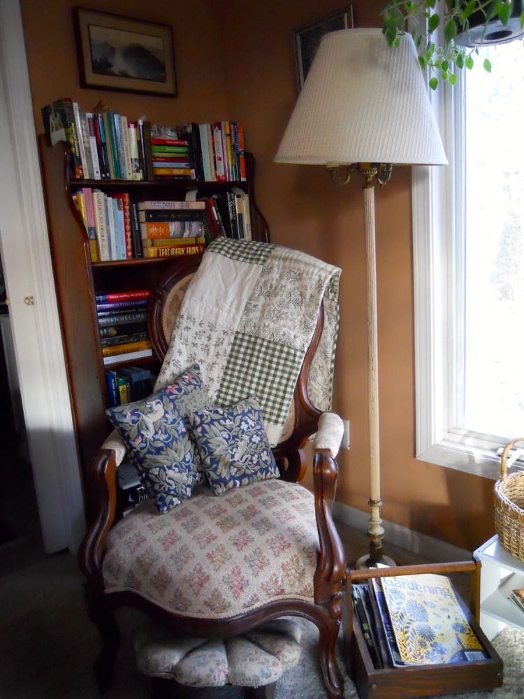 An old-fashioned chair sits in a bedroom corner to provide me with another reading space.