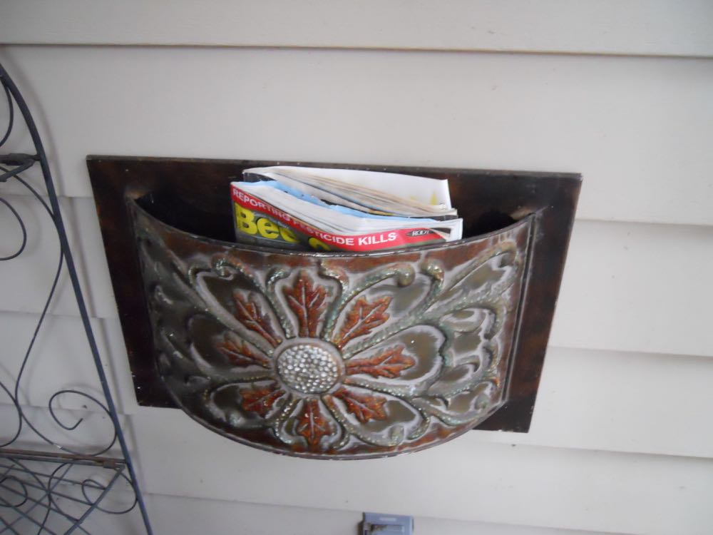 Better than a basket, this metal basket is where I can leave magazines and other reading material.