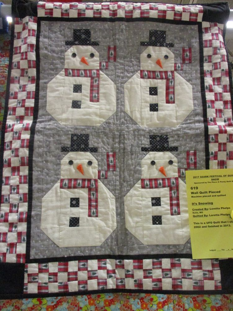 Here's the handmade quilt with all four blocks making a charming quilted wall hanging.