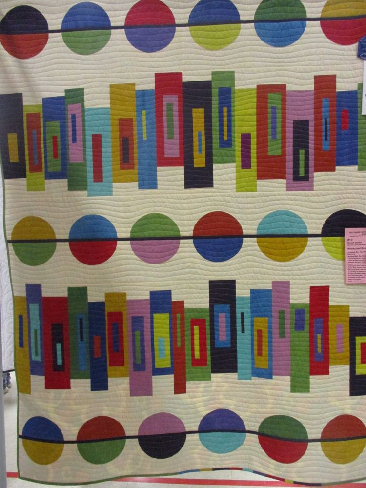 From a distance, Blocks and Beads Handmade Quilt reminds me of books on a shelf.
