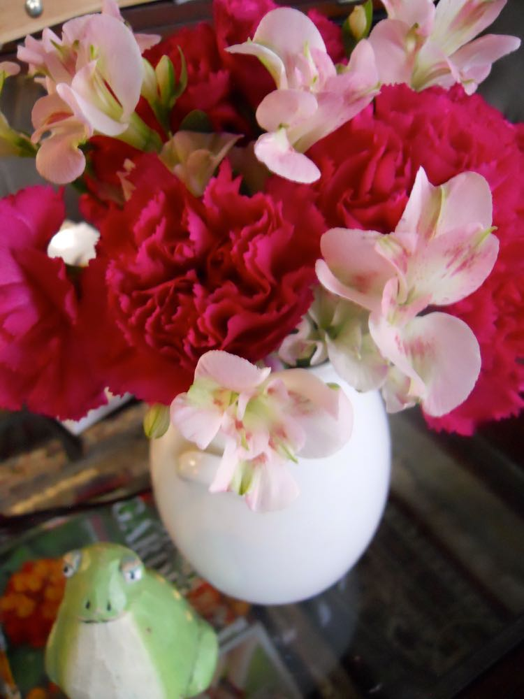 Red carnations and Peruvian lilies make a lovely, and long-lasting, flower arrangement.
