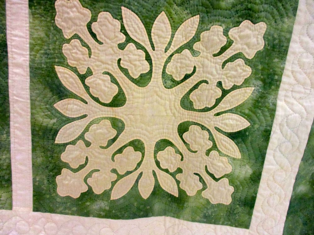 This quilt block is a favorite, look at how detailed the floral block is and how the quilting finishes the green.