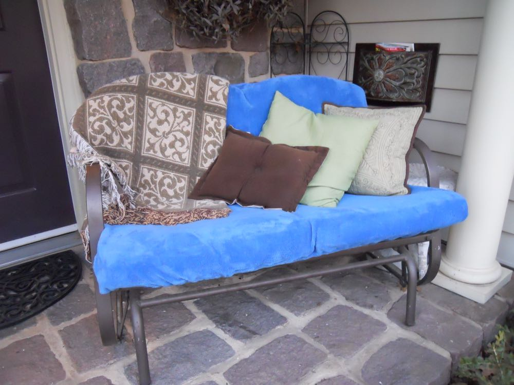 My front porch love seat with it's brand new blue, ever so soft love seat cover for $3.50.
