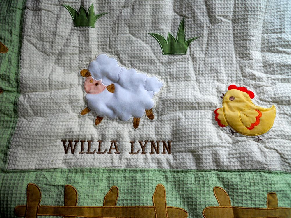 We personalized On the Farm Baby Quilt with custom embroidery on the bottom. (Photo by Charlotte Ekker Wiggins)