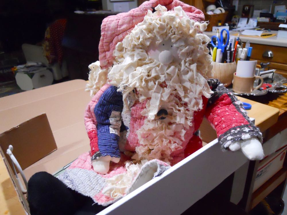 The first handmade quilt Santa doll getting ready to travel to his new home.