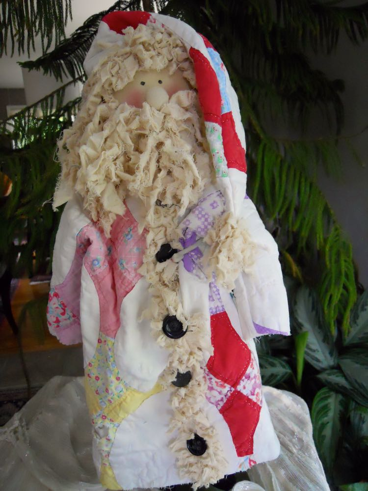 Our handmade Santa dolls repurpose old handmade quilts as Santa's holiday clothing.