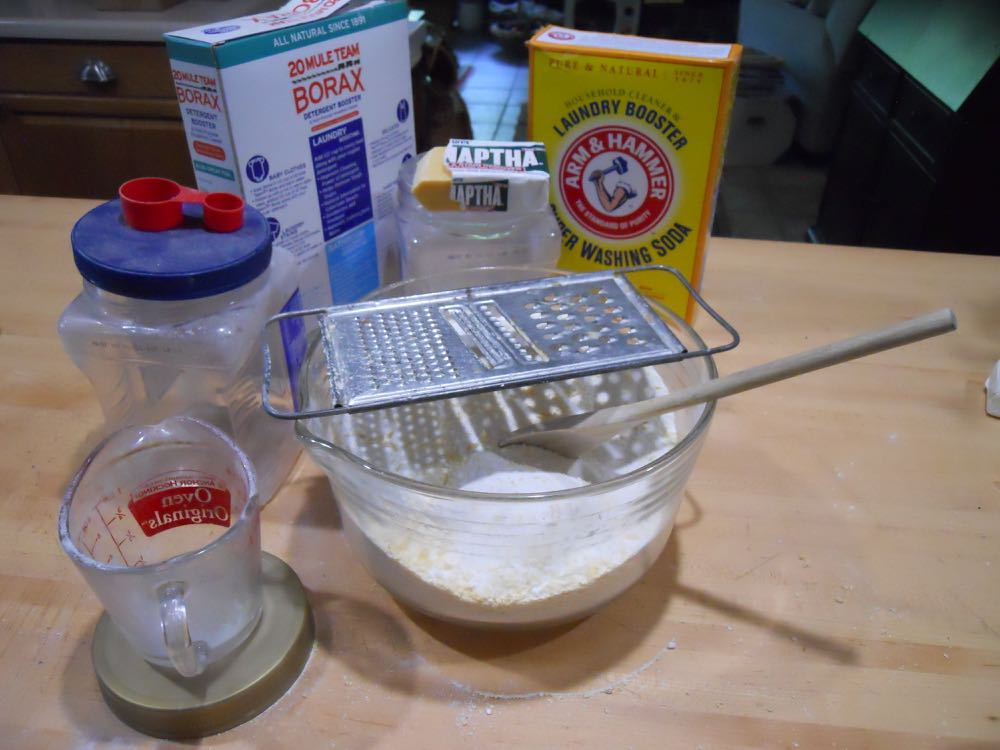 Basic ingredients, and utensils, to make homemade laundry detergent.