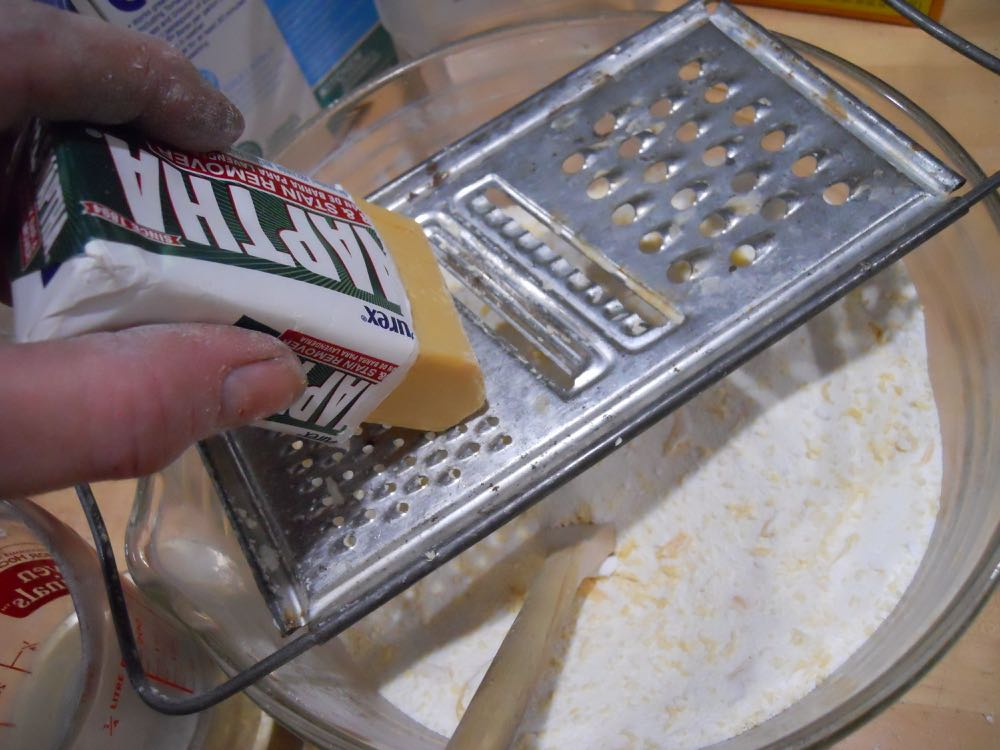 Use a cheese grater to make soap pieces to add to the laundry soap mix.