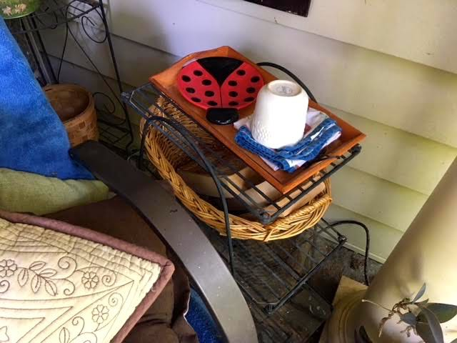 Add baskets to the wire plant stand shelves for easy handy storage.