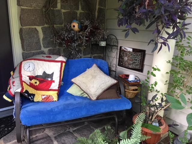 My front porch reading nook now with the wire plant stand side table.