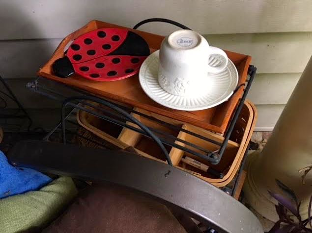 My new find, a sectioned basket that can work as a small desk next to my porch swing.