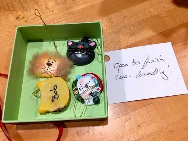 Cat ornaments in a box so she can add them. (Photo by Charlotte Ekker Wiggins)