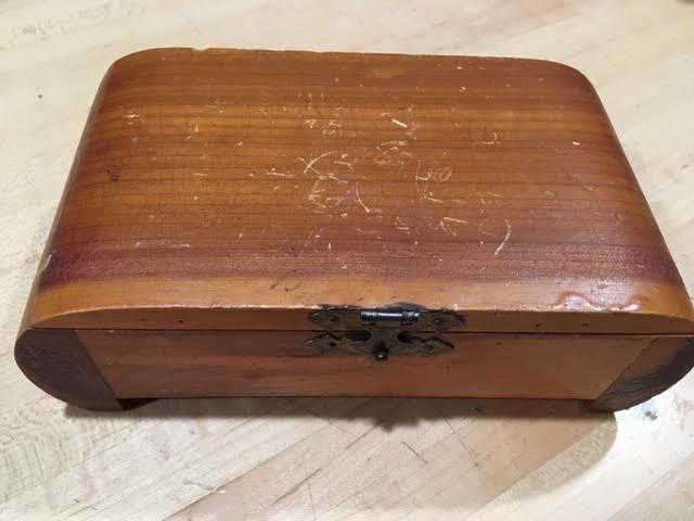 The top of the cedar box was covered in scratches. (Photo by Charlotte Ekker Wiggins)