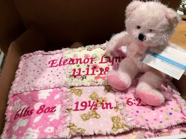 Personalized pink rag quilt gift set ready to ship. (Photo by Charlotte Ekker Wiggins)
