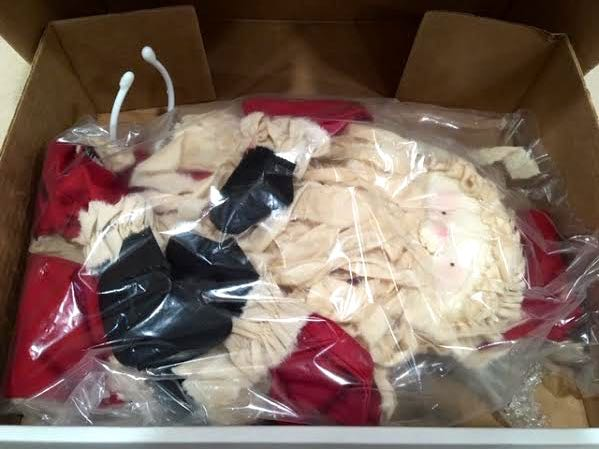 The Santa doll is in a temporary bag only for shipping. (Photo by Charlotte Ekker Wiggins)