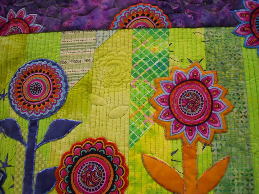 Quilting adds a lovely dimension to Lollipop Garden Handmade Quilt Wall Hanging. (Photo by Charlotte Ekker Wiggins)