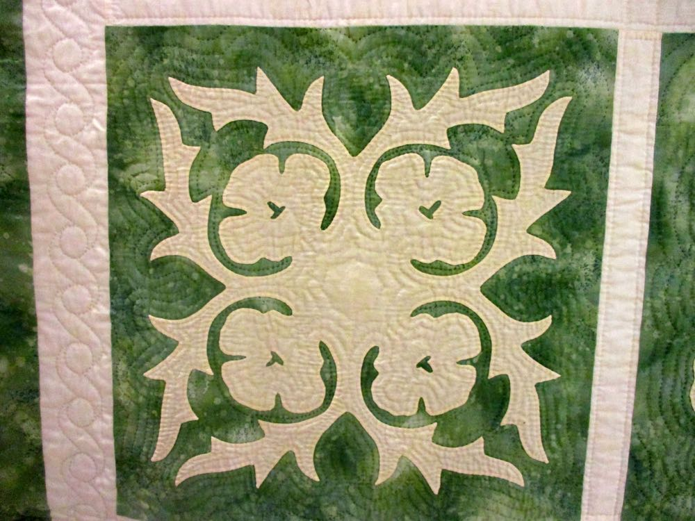 What do you see in this handmade quilt block? I think that's a hibiscus. (Photo by Charlotte Ekker Wiggins)
