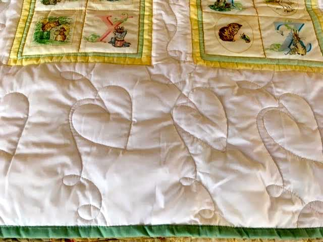 There's also space at the top and bottom of the baby quilt to add custom embroidery. (Photo by Charlotte Ekker Wiggins)