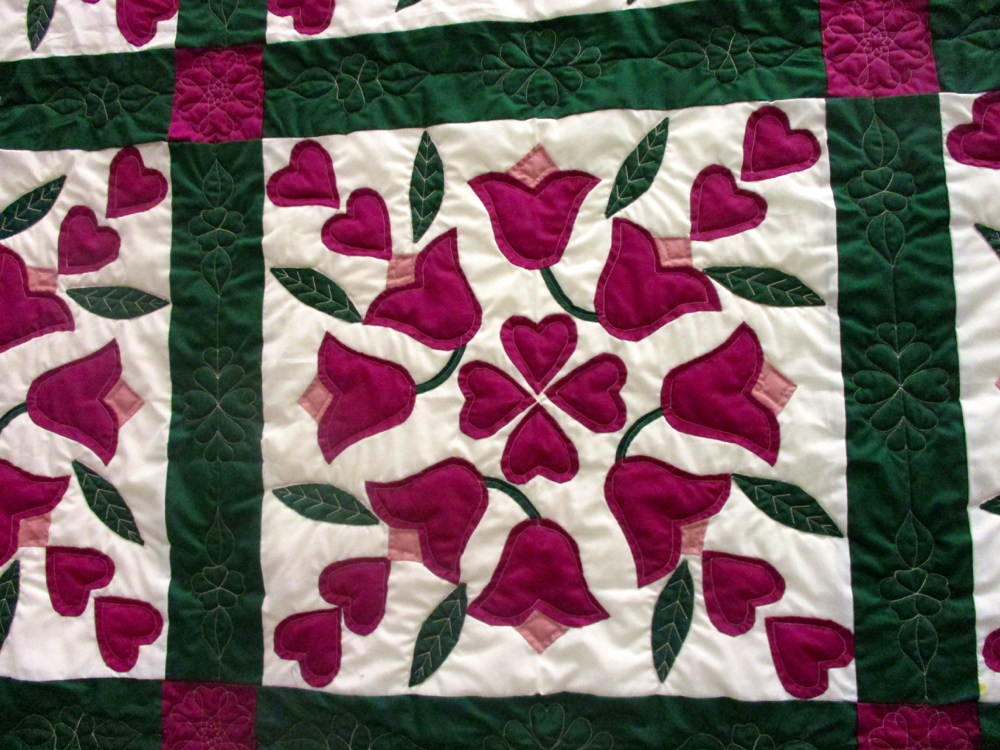 Look at the detailed quilting in Gift of Applique Handmade Quilt. (Photo by Charlotte Ekker Wiggins)
