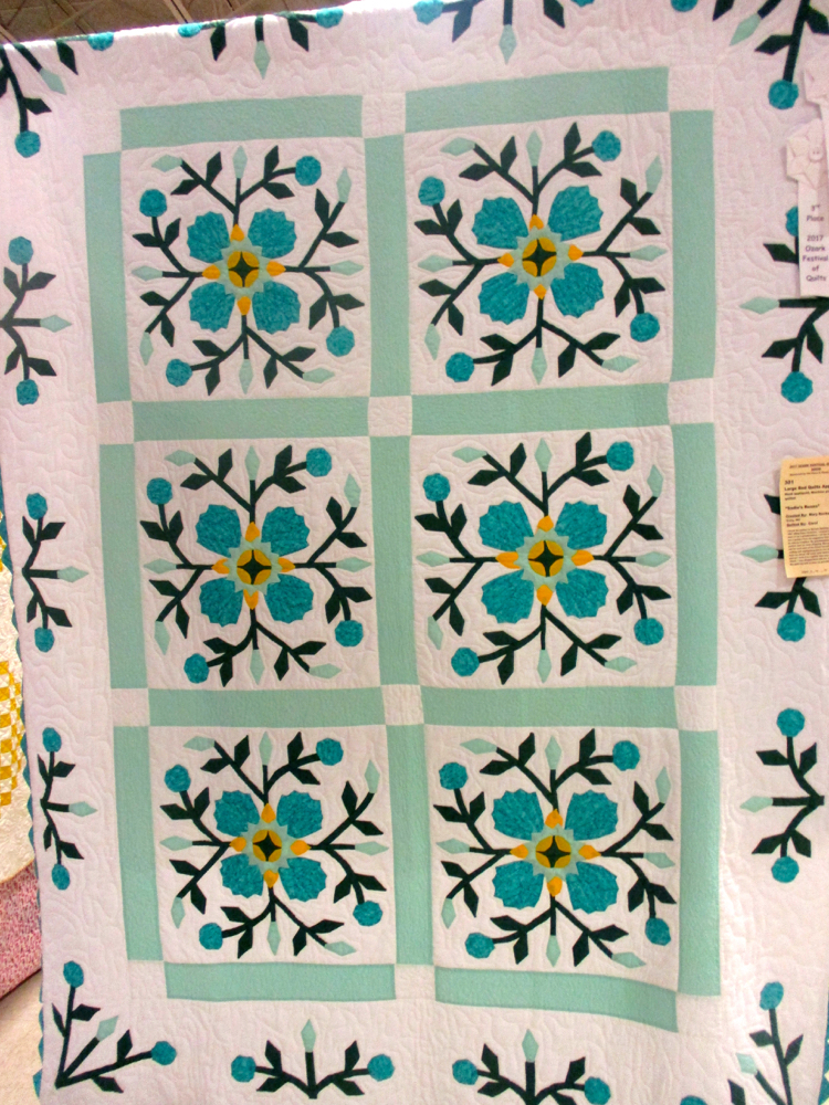 Meandering machine quilting finishes off this rose-themed handmade quilt, (Photo by Charlotte Ekker Wiggins)