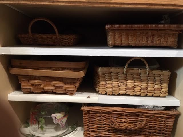 Baskets used for storage inside a kitchen cabinet. (Photo by Charlotte Ekker Wiggins)