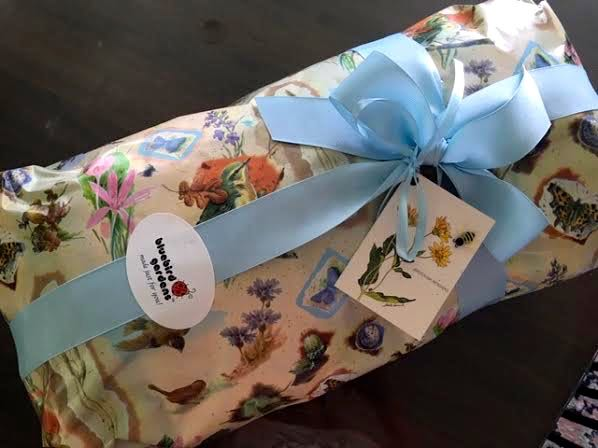 Handmade quilt gift-wrapped with the personalized card. (Photo by Charlotte Ekker Wiggins)