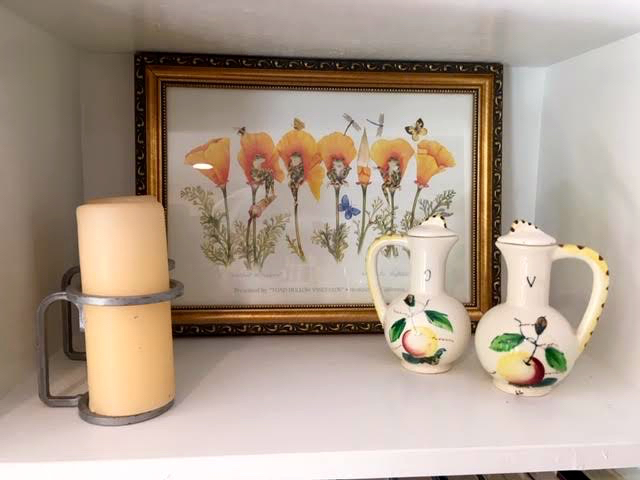 "The oil and vinegar jars now are in my basement ""Bee Bar"" kitchen. (Photo by Charlotte Ekker Wiggins)"