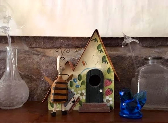 The little bluebird has joined a gift bee from a lecture and a birdhouse from a friend. (Photo by Charlotte Ekker Wiggins)
