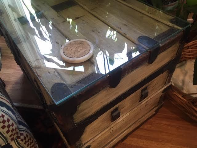 Repurpose trunks as side tables by adding a glass top. (Photo by Charlotte Ekker Wiggins)