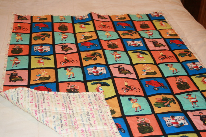A variety of Dick and Jane illustrations are on the front quilt panel. (Photo by Charlotte Ekker Wiggins)