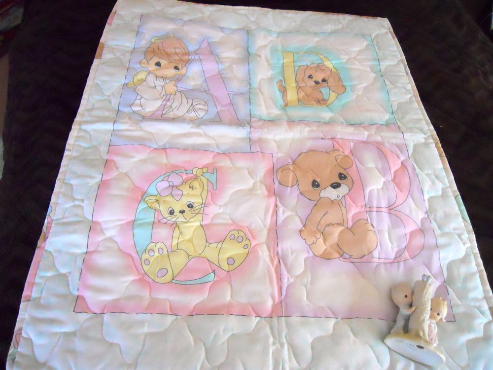 Unique baby crib quilt gift set includes a quilt and Precious Moments figurine. (Photo by Charlotte Ekker Wiggins)
