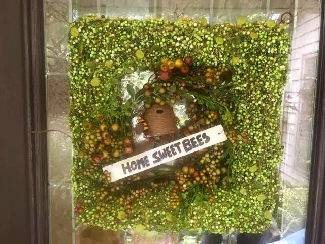 The Home Sweet Bees sign is attached to the back of the square wreath. (Photo by Charlotte Ekker Wiggins)