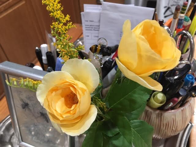 Two small yellow roses I found blooming in my hillside garden. (Photo by Charlotte Ekker Wiggins)