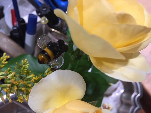 I found a use for this charming handblown glass bee, to keep my flowers company. (Photo by Charlotte Ekker Wiggins)